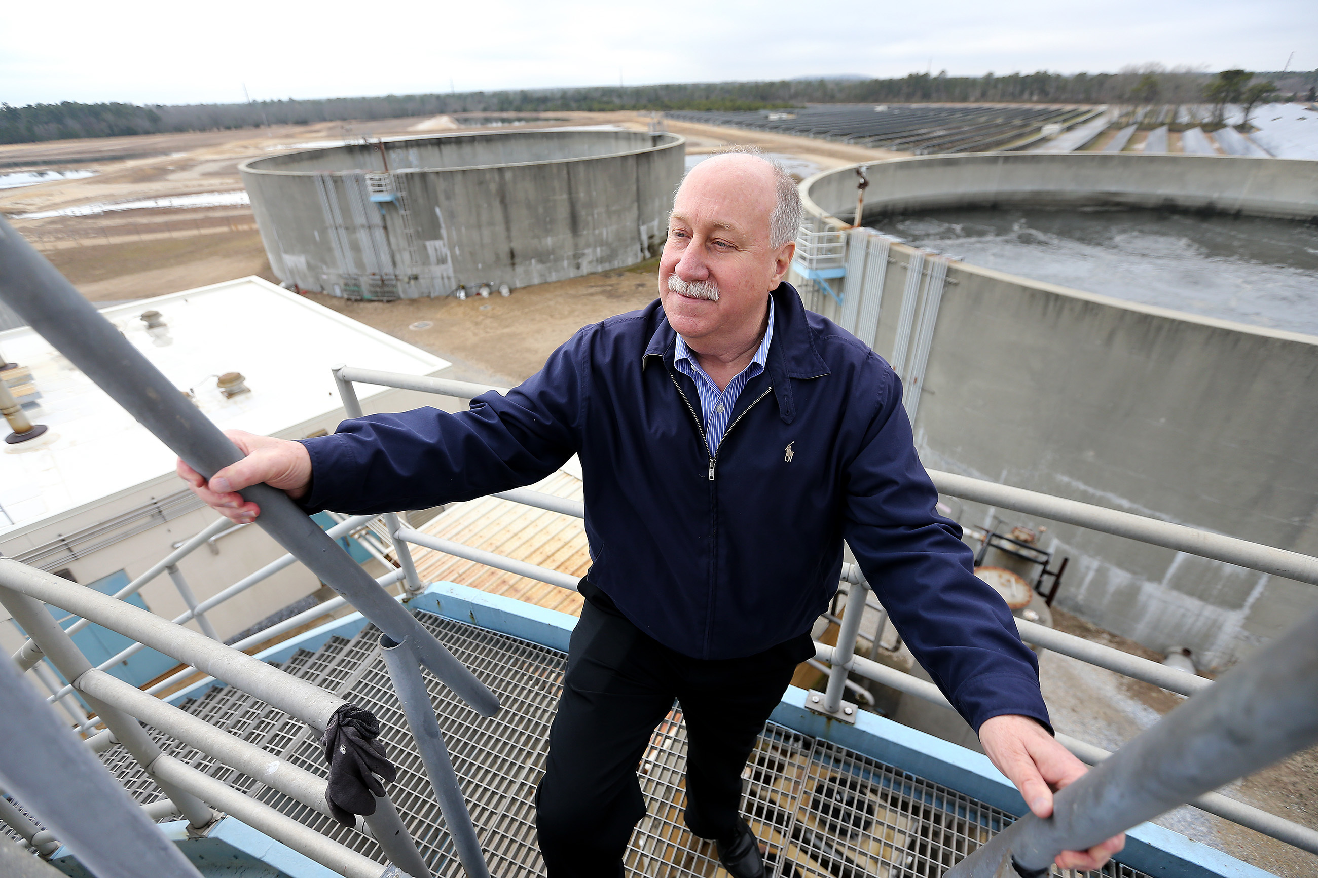 Dennis Palmer, executive director, looks over one of the sewage holding tanks at Landis Sewerage Authority in Vineland, NJ on February 7, 2019.
